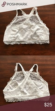 Aerie white lace bralette Lace design high neck bralette. The straps criss cross in the back. There is not padding. The bralette is a pullover. No holds, trades. aerie Intimates & Sleepwear Bras