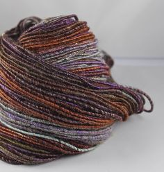 This one of a kind, art yarn was corespun from an amazing batt that was hand dyed and carded by Hobbledehoy, here on Etsy. Ive corespun this as a