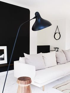 Black and white living space with modern floor lamp