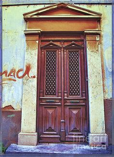 This is an old door in the capital of Syros Island in Greece Hermoupolis.