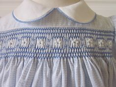 Sweet dress, fabric is shirting with woven blue dotand tiny white on white stripe. Hand pleated