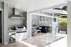 A neutral colour palette and Scyon Linea weatherboards are key for achieving a modern coastal look. House Design, New Homes, Outdoor Rooms, Weatherboard House, House, Home, Outdoor Kitchen, Indoor Outdoor Living, House Exterior