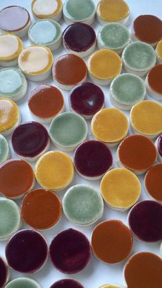 Hand made round mosaic tiles. Smaller than a quarter, you can buy these at Etsy.