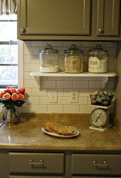 Use a small shelf to have things accessible but off the kitchen counter.  EXCELLENT idea!