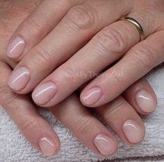 Beautiful natural soft pink gel nails with a hint of purple shimmer