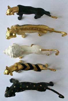 Spray painted dollar stor plastic animals. A sexy decor item - these could also be used as drawer pulls.  May not stand up to heavy use, but for a light duty or occassional use item they would look great.