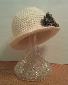 This is a cute hat for the winter time. It only takes one skein of bulky yarn to complete so it makes a quick and affordable gift. Pair with a flower embellishment for a little extra pizazz!