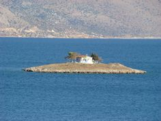 Itea islets - seven in total, they can be seen and reached from the main beach of the town Itea. The major ones are Agios Athanasios, Agios Konstantinos and Agios Dimitrios. The first two were once connected by a stone bridge, the ruins of which still lie in the sea. #Greece #Delphi #Terrabook #Travel #GreeceTravel #GreecePhotografy #GreekPhotos #Traveling #Travelling #Holiday #Nature
