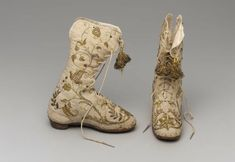 Board #6 - Renaissance - Shoes - Kylie Steele Pair of children's boots. Silk with gilt metal and sequin embroidery, silk cord, silk ribbon, metal thread tassels, linen lining, and leather. 1550-1650.  http://www.mfa.org/collections/object/pair-of-children-s-boots-121933