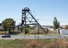 Abandoned gold mines and their detritus litter modern day Johannesburg Johannesburg Africa, Luxury Travel, Utility Pole, Abandoned, Modern, Gold, Left Out, Trendy Tree, Ruin