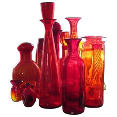 A collection of large, red-orange Blenko pieces, largest measuring H. Antique Furniture, Modern Furniture, Blenko Glass, Genie Bottle, Colored Vases, Glass Company, Glass Collection, Vintage Glassware, Vintage Colors