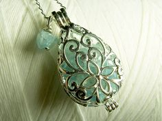 Worry Locket  aquamarine gemstones in teardrop locket by GhostShip, $27.00