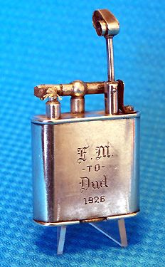 Dunhill Unique Lighter  c. 1926. Silver plated lift arm lighter.