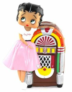 This lovable Betty Boop Doll bank would be a joy to have for any Betty Boop fan. Betty is wearing her Pink poodle skirt and white sweater with her name on it . Betty is leaning against a 50's style juke box. juke box music 50's style is played each time a coin is inserted into her juke box. This ...