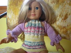 I did a knitting for sewing trade recently and knitted a halter top for an American Girl doll.  I didn't know that AG doll's torsos are clo...