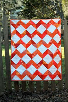 I love orange!  Simple quilt made with half-square triangles.