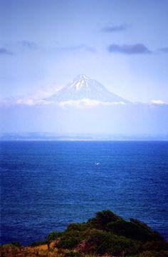 The 7572 ft volcano, Mt Taranaki is the dominant landmark of the surrounding North Island dairyland province, New Zealand