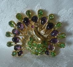 Mr. Waxman was the partner of Edward Swoboda, who passed in 2013, at age 95. This Swoboda peacock pin is done in goldtone, and is adorned with semi-precious amethyst and peridot stones. The eye is accented with a genuine ruby. | eBay!