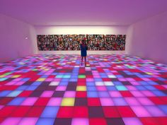 """12 July 2014 A woman stands in a creation by Polish artists Piotr Uklanski entitled """"Dancing Nazis"""" displayed during the contemporary art exhibition """"ArtLovers"""" in the Grimaldi Forum in Monaco"""