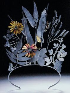 A tiara made to look like wildflowers, made out of oxidized metals.