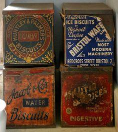 Vintage biscuit tins from the Lanhydrock pantry in Cornwall √