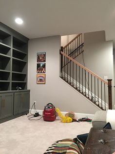 DIY Banisters | Still Dreaming of a Finished Basement | April Colleen Home, Diy Stairs, Banisters, Home Remodeling, Half Walls, Diy Basement, Finishing Basement, Diy Staircase, Diy Stair Railing