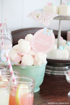 Love (!) the pale, girly hues at work in this table of vintage inspired sweet treats, including these darling dipped marshmallows