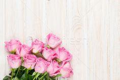 Pink roses bouquet over wooden table stock photo (c) karandaev (#5564757) | Stockfresh