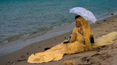 In Cambodia, a bride wore a bright-yellow dress and matching headpiece.