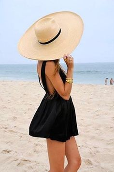 Summer perfection  Short flirty black dress and a maxi hat