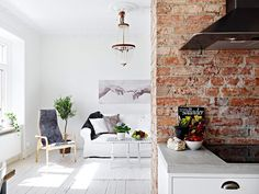 """White is the predominant color throughout in this Gothenburg home, aesthetically contrasting the masonry red brick wall and the tasteful furniture additions."" http://www.cuded.com/2012/06/lovely-planned-apartment/"