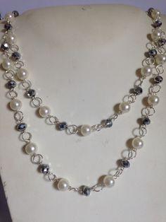 #collana #metallica con #perle #sintetiche e #cristalli #grigi  in fila doppia. Su www.oro18.eu #oro18 #bigiotteria #bijoux Info@oro18.eu Euro 14,90
