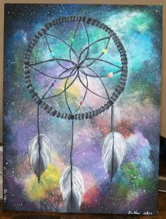 dreamcatcher painting! this one I love it kind of represents that your dreams are huge such as with the galaxy background.