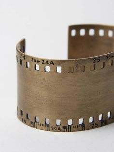 Jewelry | Jewellery | ジュエリー | Bijoux | Gioielli | Joyas | Art | Arte | Création Artistique | Precious Metals | Jewels | Settings | Textures | toby jones 35Mm film strip cuff
