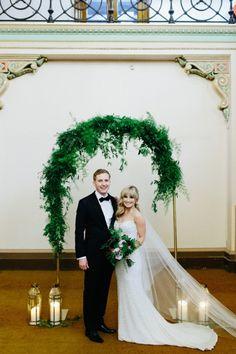 Newlyweds With Greenery Arch | Ed Sloane Photography on @polkadotbride via @aislesociety