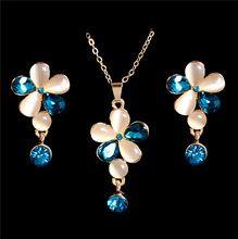 591aa5d138f5 Envío gratis 18 K Gold Filled exquisito flor bonita ojo de gato collar  pendientes joyería de