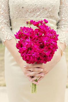 The bridesmaids will carry bouquet of fuchsia stock flowers wrapped in sage green ribbon with the stems showing.