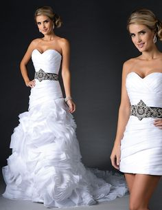 We absolutely adore this couture look! It is a beautiful two piece bridal gown with a long ruffled bottom that is perfect for your ceremony. And when it comes to reception time, you can remove that piece and dance the night away in a beaded short party dress! This unique dress comes with a detachable sash and beads through the top. The perfect wedding gown! Available to order at the Foothills Bridal Gallery!  Style: aa9290 Milano Formals