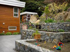 Built in sandbox landscaping for the kids? Genius.