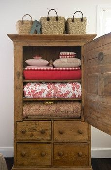 Find an old TV armoire and add shelves to recreate.  Painted would be even better...