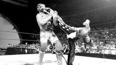 Shawn Michaels gives Hulk Hogan Sweet Chin Music.