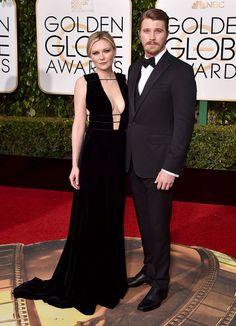Very low-cut! Smashing. Kirsten Dunst and Garrett Hedlund