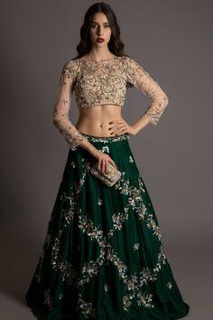dec83e41b1 cream and green lehenga, skin color full sleeves blouse, darg green skirt,  silver