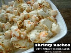 Shrimp Nachos topped with an ooey, gooey garlic cheese sauce! #appetizer #seafood