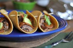 Pulled Pork Tacos with Mole Sauce | http://www.theroastedroot.net