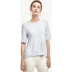 Ann Taylor Petite Mixed Media Peplum Top ($60) ❤ liked on Polyvore featuring tops, pale lavender luster, petite peplum top, white peplum top, white short sleeve top, lavender peplum top and wet look top