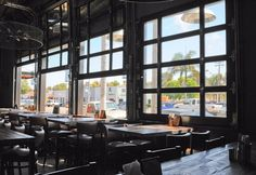 Glass garage doors separate tap room and production. Also replace exterior roll up doors with windows or rollups like these. Garage Door Windows, Glass Garage Door, Garage Door Design, Windows And Doors, Glass Doors, Brewery Design, Restaurant Design, Restaurant Patio, Industrial Garage Door