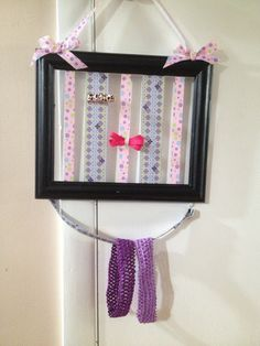 Hair bow/ clip and headband holder! Made from and old picture frame, sanded and painted with ribbon attached to the back. Perfect for a little girls room!!