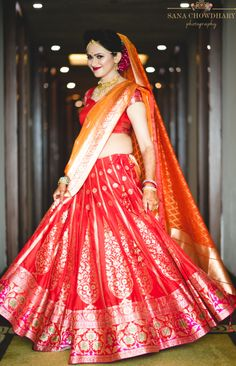 Wedding Lehenga - Bride in a Benarsi Red Lehenga with an Orange Dupatta | Photo By: Sana Chowdhary Photography #wedmegood #indianbride #bridalwear #bridallehenga #redlehenga #orange #benarsilehenga #weddinglehenga #lehenga