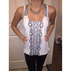 Beaded Tank Top with Front Detail Beaded tank top by forever21. Beads on straps and some on the front where print detail is. No flaws. Forever 21 Tops Tank Tops